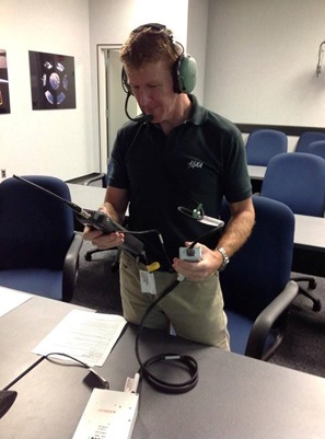 Tim training using a replica Amateur Radio.