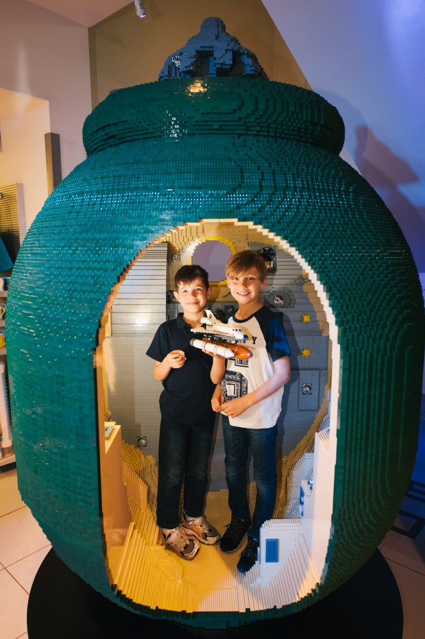 Brothers (l to r) Asten, age 6 and Kye Sciberras, age 8 play in the Lego Soyuz capsule Super-size Lego City Spacecraft lands at The Science Museum. Crafted by a team of LEGO® City Space Master Builders - in association with the UK Space Agency - the Soyuz Capsule build is now in situ at the Science Museum. Modelled on the spacecraft that will deliver British ESA astronaut Tim Peake into space later this year the replica took 650 hours to build using 160,000 LEGO® bricks. Soyuz is a series of spacecraft designed for the Soviet space programme in the 1960s that remains in service today. The LEGO® build is based on the Soyuz Capsule Orbital module that provides accommodation for the crew during their mission. Two thirds the size of the real capsule the detailed design spans 7m by 2.5m and includes a sit in section for young visitors to the attraction. For further information please contact Louise Hathaway or Louise Illes at the Lego press office on 01608 812 830 or louise@nortonandco.com or louiseiles@nortonandco.com PR Handout Copyright: © Mikael Buck / Lego +44 (0) 782 820 1042 http://www.mikaelbuck.com