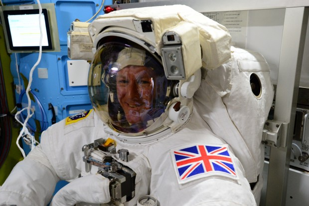 Tim trying on his spacesuit, preparing for EVA. Credit ESA/NASA