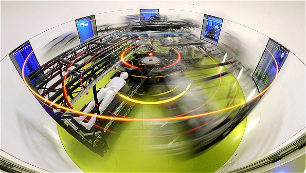 Image Credit: DLR. This is the German Space Agency's human centrifuge at the ':envihab' facility in Cologne. By spinning people, blood is encouraged to flow back towards the feet as artificial gravity is created.
