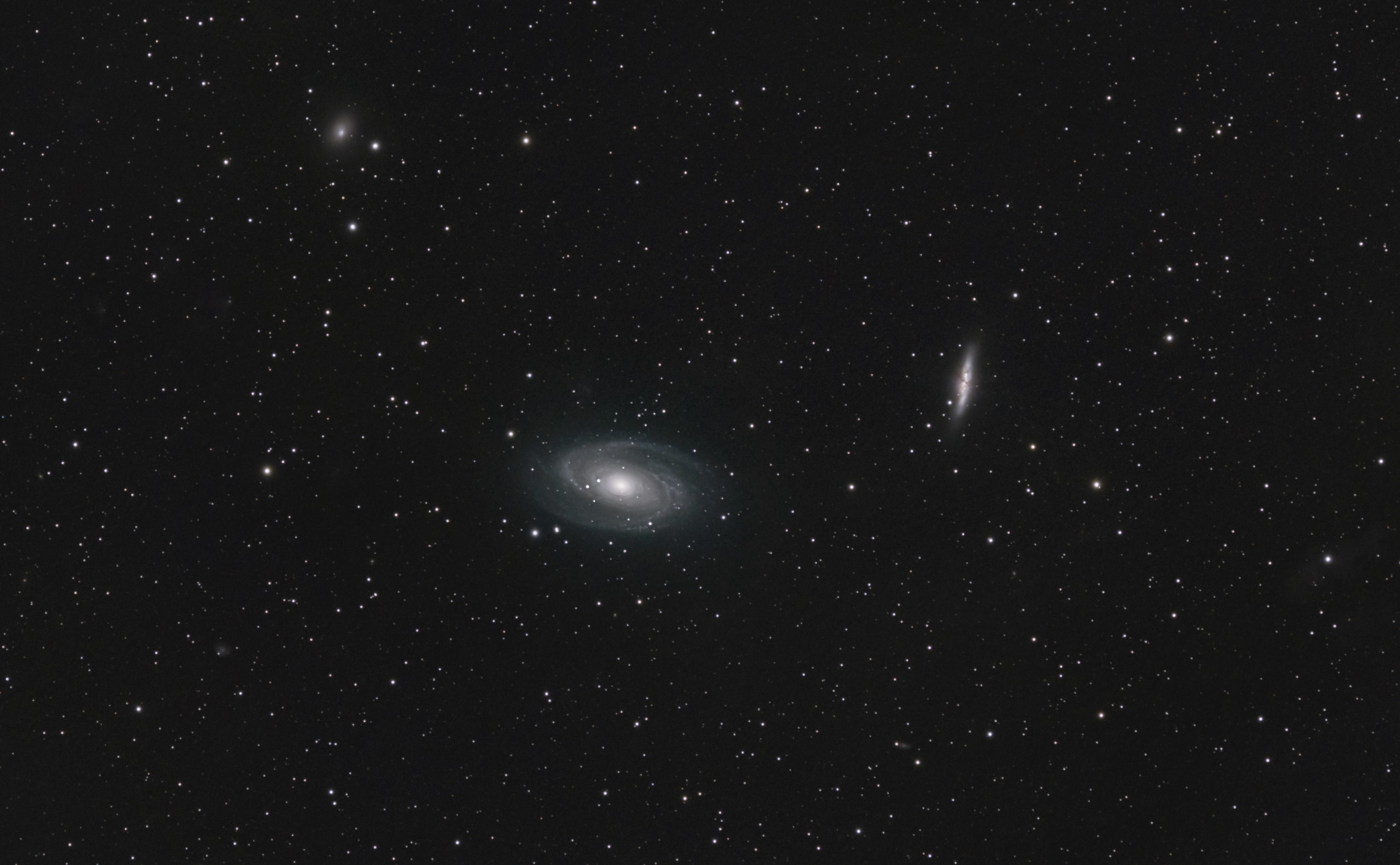 An image of Bode's Galaxy (left), the Cigar Galaxy (right) and the Garland Galaxy (top left).