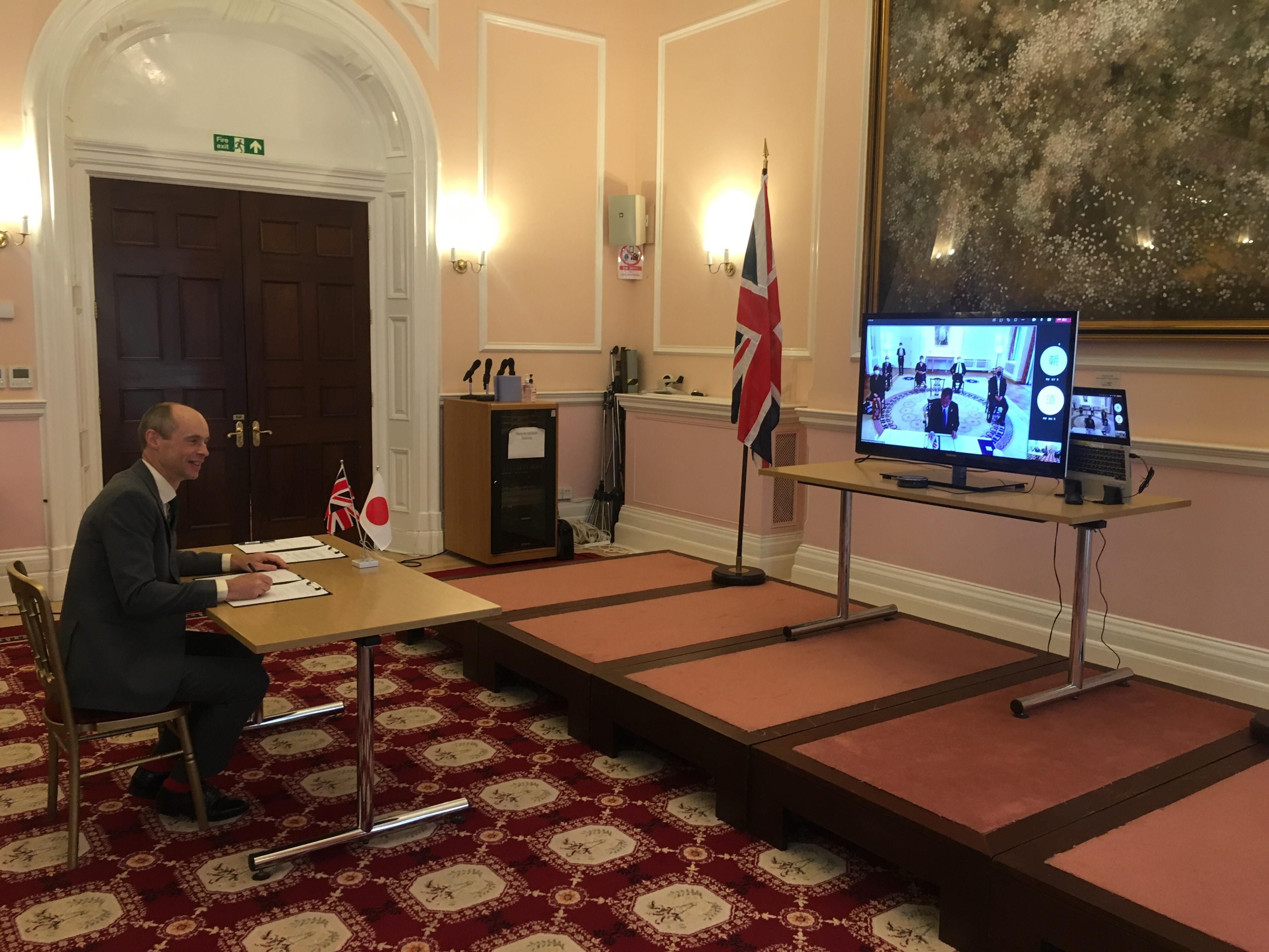 UK Space Agency CEO, signing a Memorandum of Cooperation with the Japanese Aerospace Exploration Agency (JAXA).
