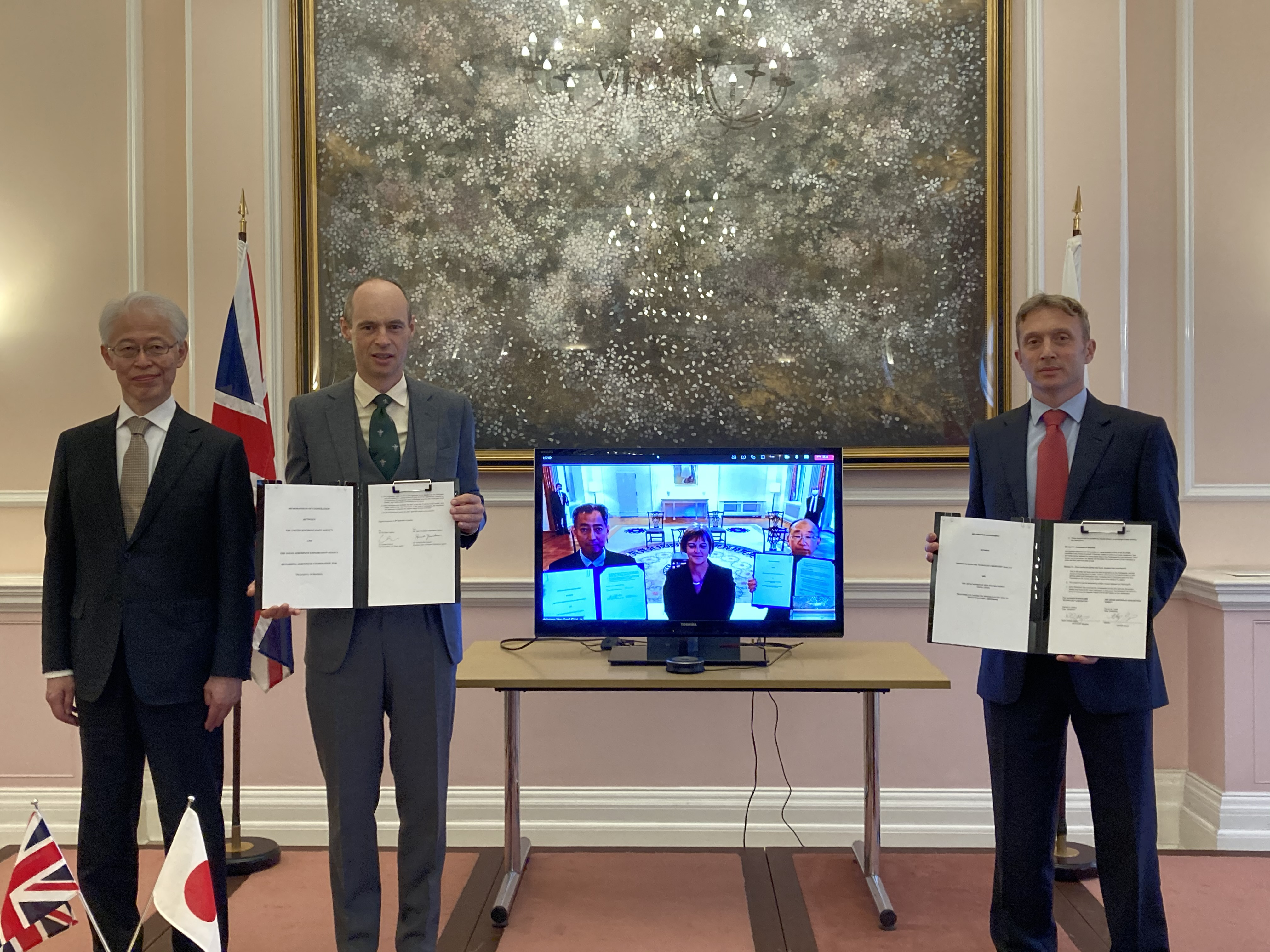 Left to right: Japanese Ambassador, UK Space Agency CEO and DSTL Space Group Leader (on the screen are British Ambassador, JAXA President and JAXA Director)